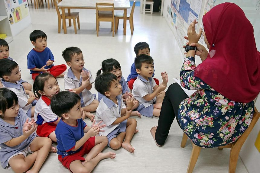 A pre-school teacher conducting a lesson with her class at PCF Sparkletots Preschool @ Fengshan.