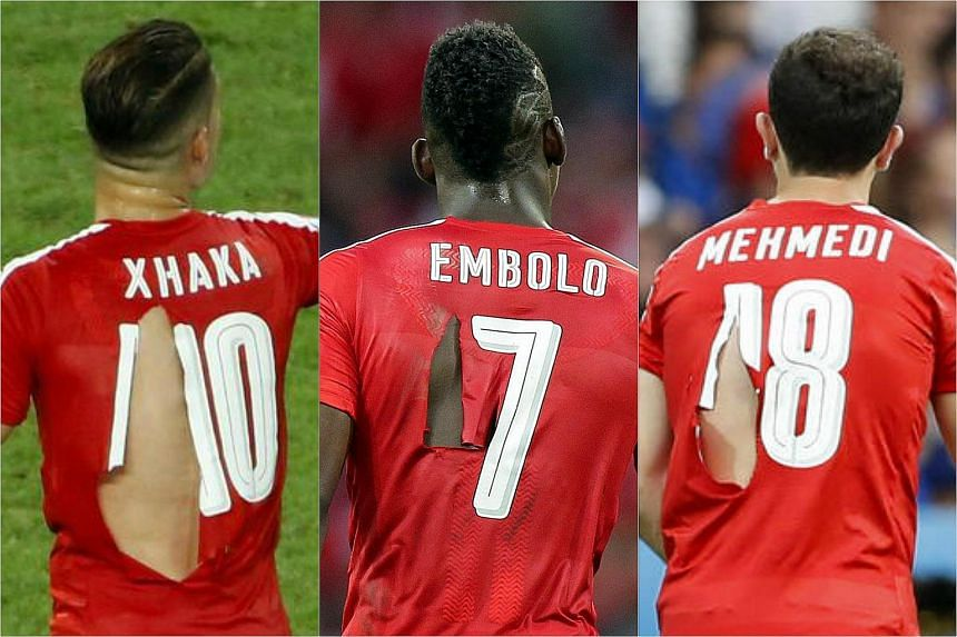 (From left): Granit Xhaka, Breel Embolo and Admir Mehmedi with ripped shirts during the Uefa Euro 2016 group A preliminary round match between Switzerland and France.