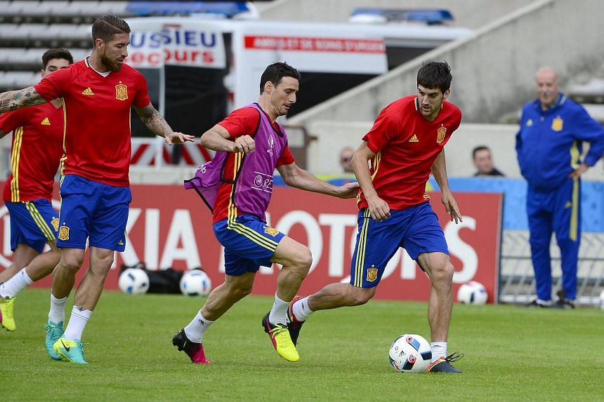 Spanish players (from left to right) Sergio Ramos, Aritz Aduriz and San Jose in action during a training session of the Spanish national soccer team at Chaban Delmas Stadium in Bordeaux, France, on June 20.