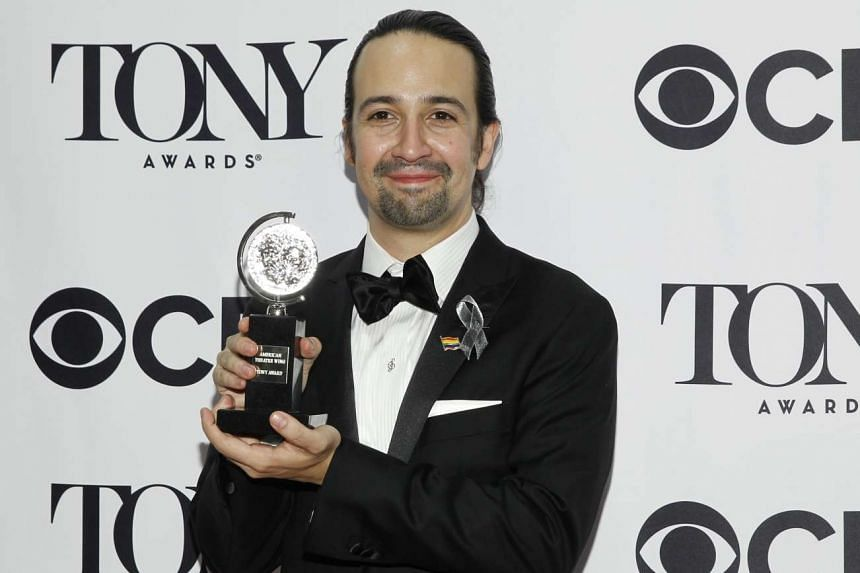 Lin-Manuel Miranda (above), creator of Hamilton, with one of 11 Tony Awards won by the musical on June 12.