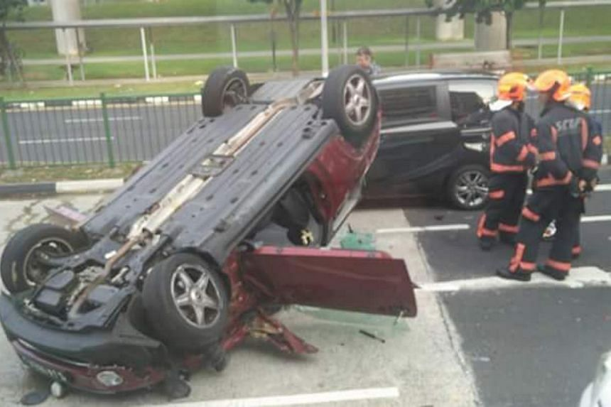The overturned car was involved in a collision with another car and a lorry.