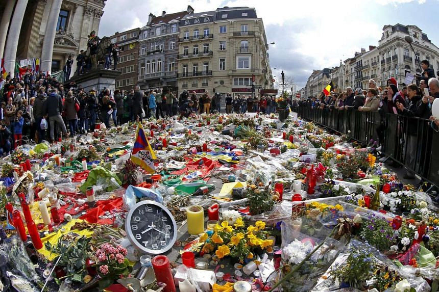 People take part in a rally in memory of the victims of the bomb attacks in Brussels metro and Brussels international airport on April 17, 2016.