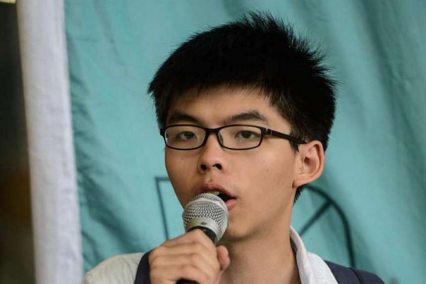 Hong Kong student leader Joshua Wong speaking to the media outside the Eastern Law Court in Hong Kong on June 7, 2016.