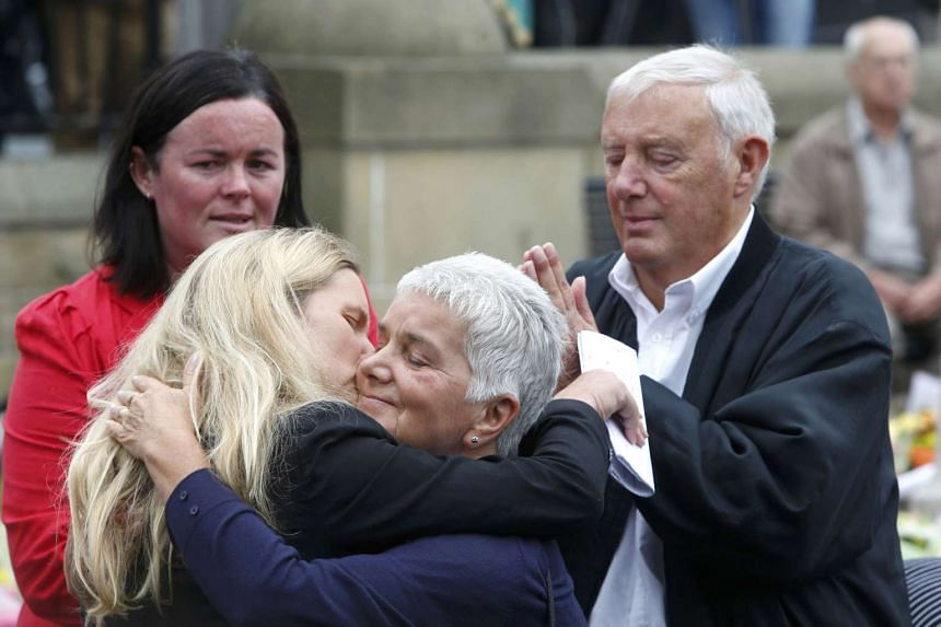 The mother of murdered Labour Party MP Jo Cox, Jean Leadbeater (centre) embraces her daughter Kim as her husband Gordon watches in Birstall, Britain on June 18, 2016.