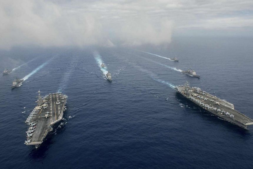 The US aircraft carriers John C. Stennis (left) and Ronald Reagan conducting joint operations in the Philippine Sea on June 18, 2016.