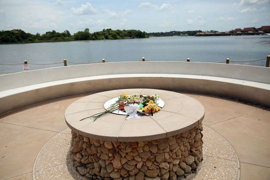 Flowers are left at a closed section of beach following the death of a two-year-old boy who was killed by an alligator near a Walt Disney World hotel on June 18, 2016 in Orlando, Florida.