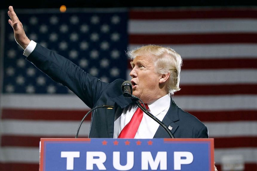 Republican presidential candidate Donald Trump waves to the crowd of supporters during a campaign rally on June 18, 2016 in Phoenix, Arizona.