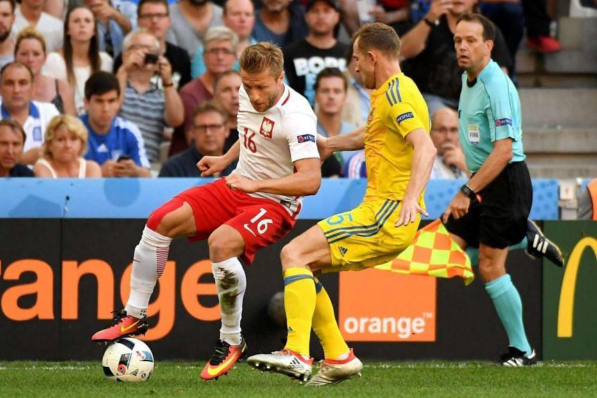 Poland's Jakub Blaszczykowski (left) and Olexandr Kucher (right) of Ukraine in action during the Uefa Euro 2016 group C football match.