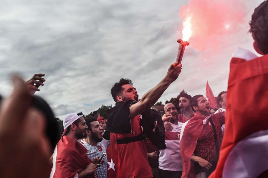 Turkish fans light flares in Lens ahead of their UEFA Euro 2016 group D preliminary round match between Czech Republic and Turkey at Stade Bollaert-Delelis in Lens Agglomeration, France, on June 21, 2016.