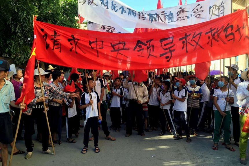 Residents of Wukan village demonstrating for the release of village chief Lin Zuluan, on June 22, 2016.