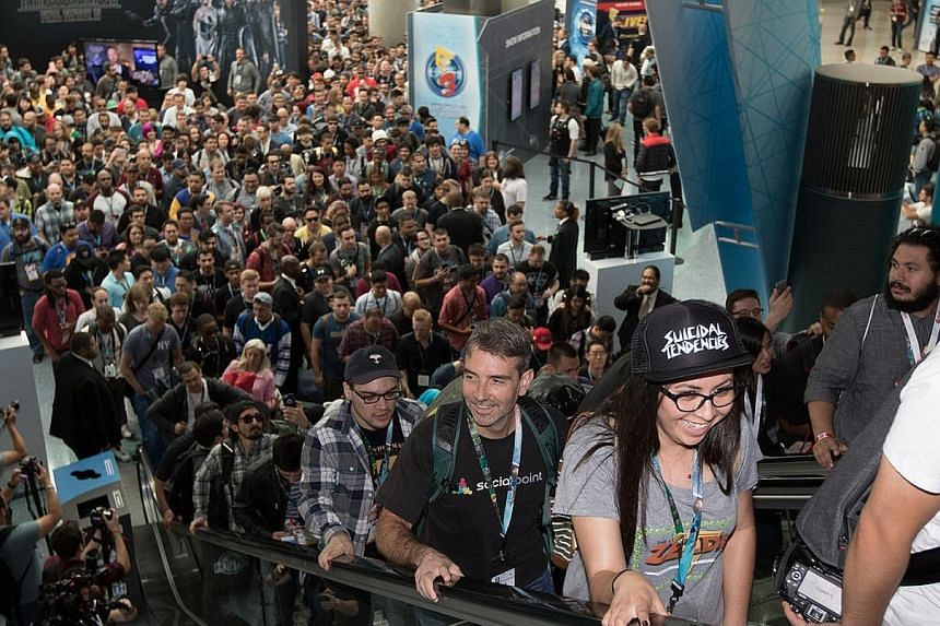 Happy gamers just can't wait to try out the latest games at last week's annual Electronic Entertainment Expo trade show in California.