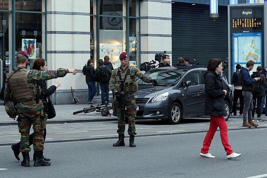 Belgian forces were deployed and tight security checks carried out in Brussels yesterday after police received a phone call from a man claiming he had been abducted and forced to wear an explosives belt. It turned out to be a fake bomb belt containin