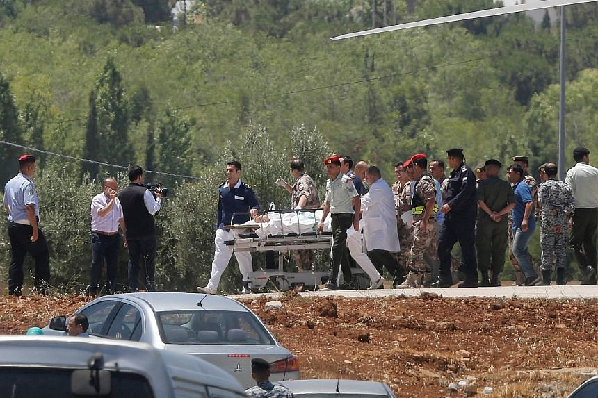 An officer who was injured during yesterday's attack near the borders of Jordan, Iraq and Syria was transported by helicopter to a hospital in the capital, Amman.
