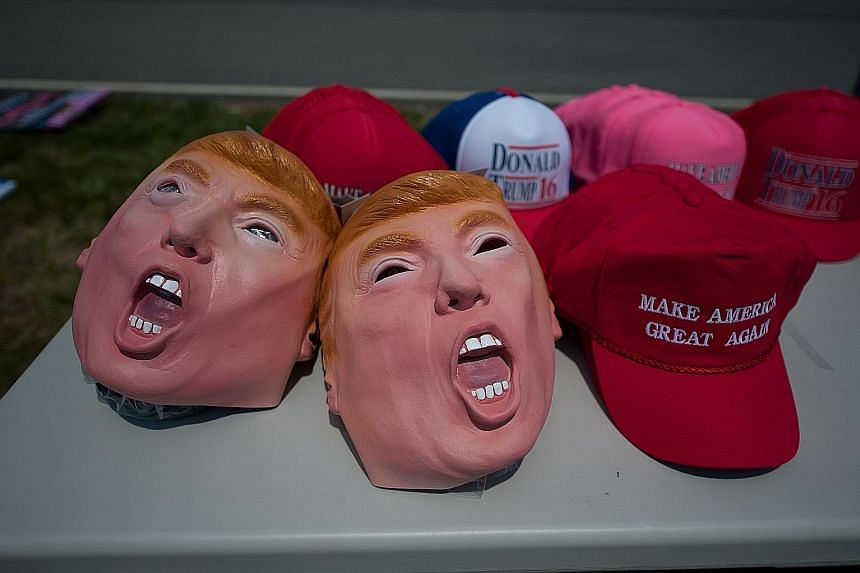 Trump memorabilia for sale at a rally in Moon Township, Pennsylvania, on June 11. A shortfall in funds leaves Mr Trump extraordinarily dependent on the Republican National Committee.