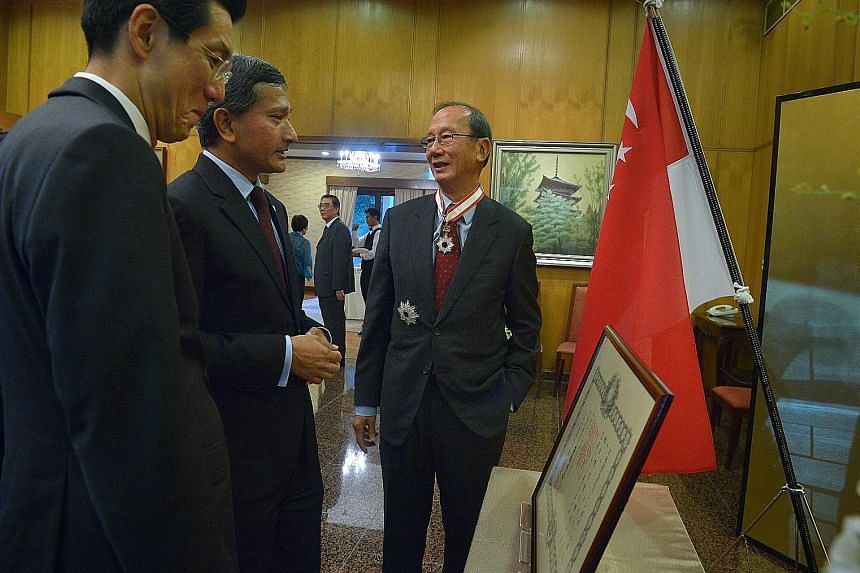 Former ambassador to Japan, Mr Chew (right), with the Japanese Ambassador to Singapore, Mr Shinoda (left) and Dr Balakrishnan after Mr Chew was conferred the Order of the Rising Sun, Gold and Silver Star.