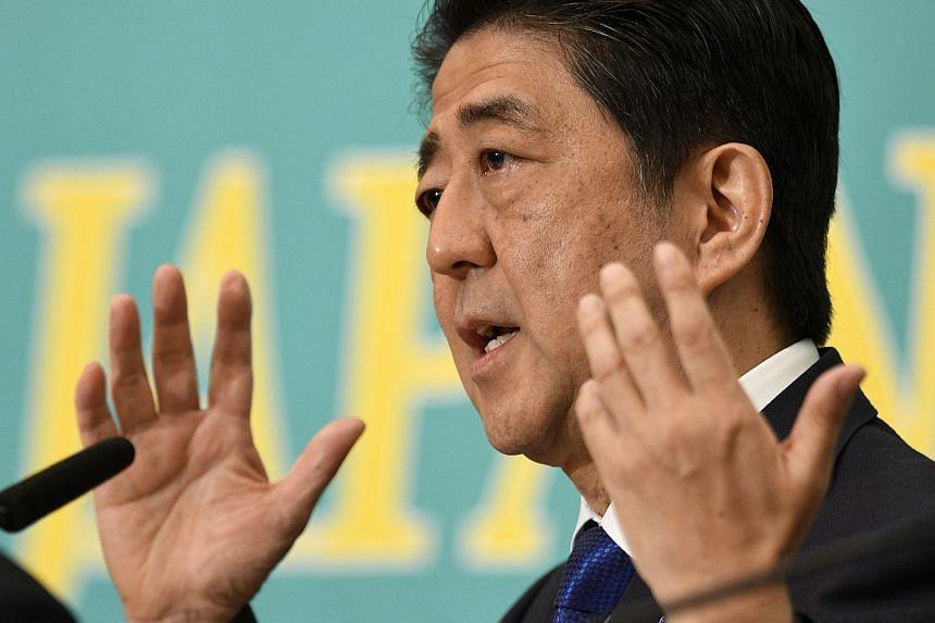 Shinzo Abe speaks during a party leaders' debate at Japan National Press Club in Tokyo.