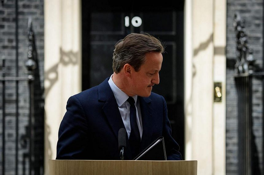 British Prime Minister David Cameron leaves the lectern after speaking to the press in front of 10 Downing street in London.