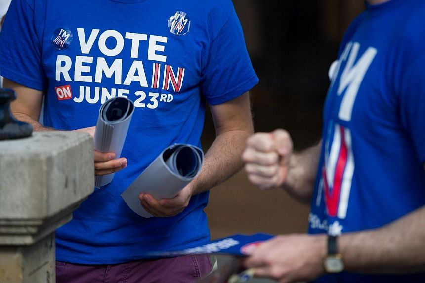 """Campaigners from the """"Vote Remain"""" group hand out stickers, flyers and posters in Oxford Circus, London."""