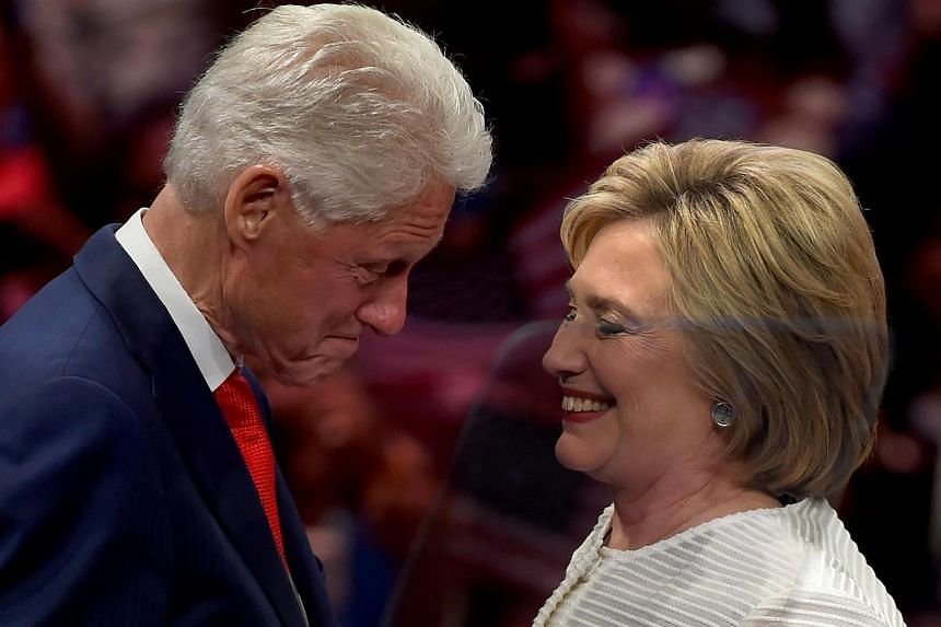 Hillary Clinton (right) shares a moment on stage with husband, former US president Bill Clinton during her primary night event at the Duggal Greenhouse, New York.