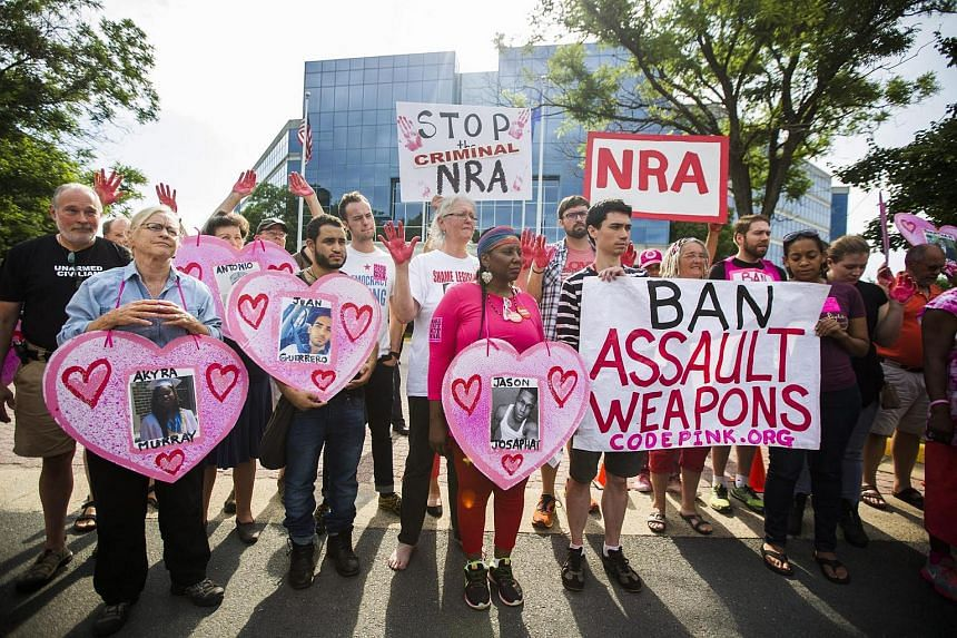 Demonstrators hold a protest outside the headquarters of the National Rifle Association (NRA) in Fairfax.