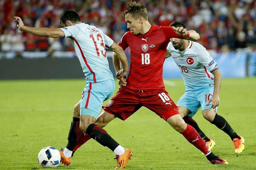 Josef Sural of Czech Republic (centre) and Ismail Koybasi of Turkey (left) in action during their Uefa Euro 2016 group D football match.