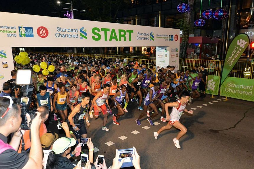 Participants beginning the race at the start of the Standard Chartered Marathon Singapore on Dec 6, 2015.