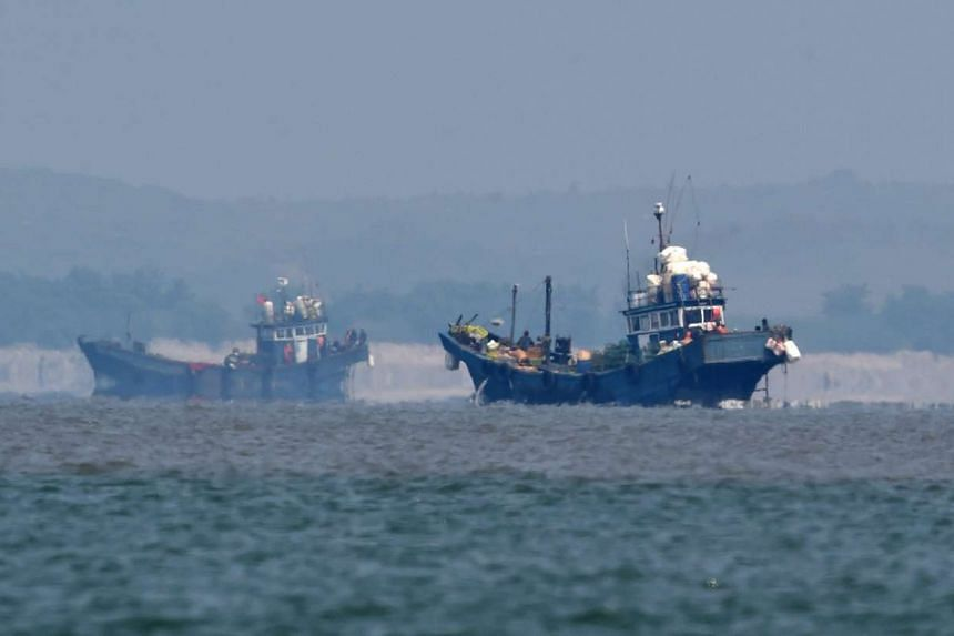 Alleged illegal Chinese fishing vessels are seen in neutral waters west of South Korea on June 10, 2016.