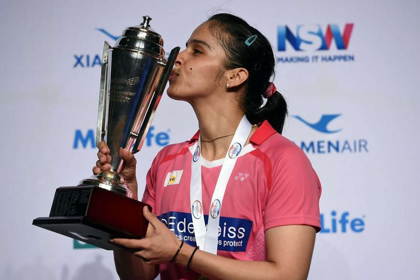 India's Saina Nehwal kissing the trophy after the women's singles at the Australian Open Badminton tournament in Sydney on June 12, 2016.