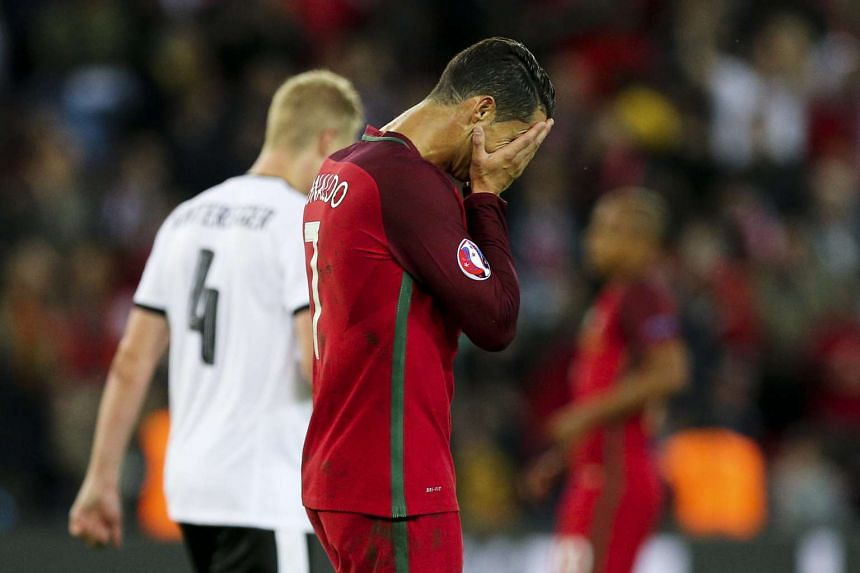 Portugal's Cristiano Ronaldo reacting after missing a penalty during the Euro 2016 match against Austria at Parc des Princes in Paris, France, on June 18, 2016.