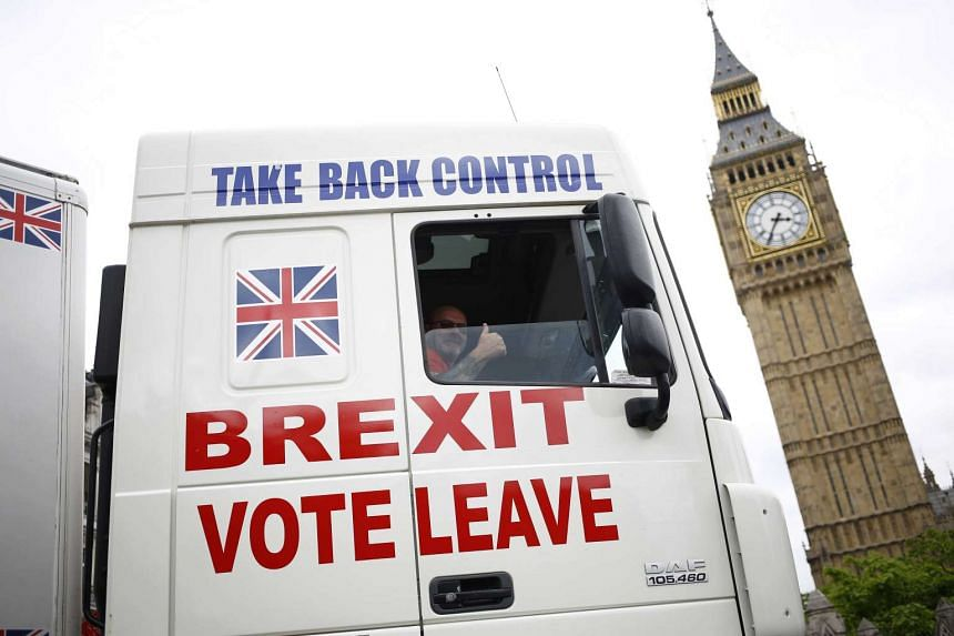 A truck is driven past Parliament in London on June 21, 2016, ahead of Britain's EU membership vote.