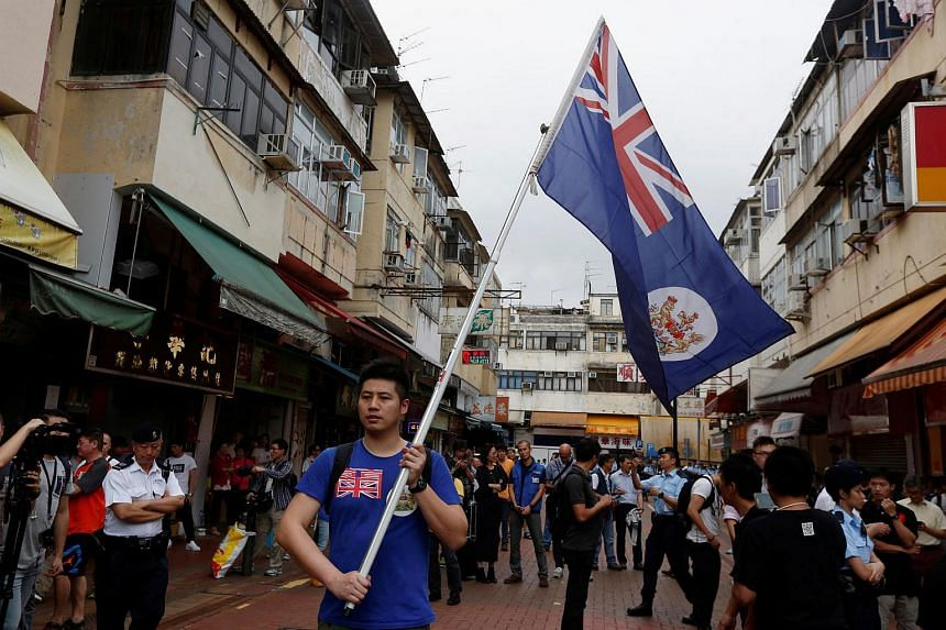 A local protester against mainland Chinese parallel traders carries a British Hong Kong colonial flag in Hong Kong, China.