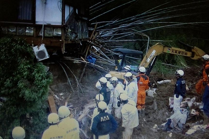Police officers and firefighters during rescue operations following a landslide in the southern Japanese city of Kumamoto.