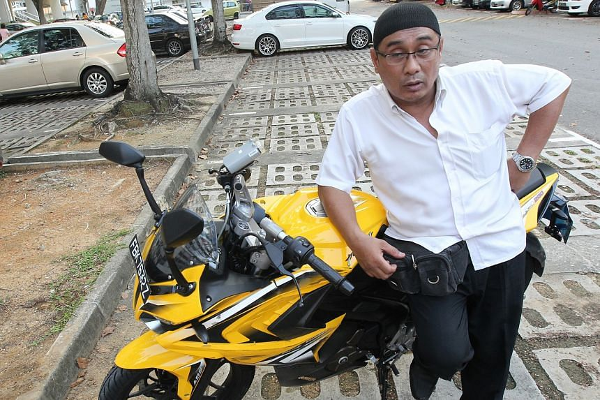 Mr Bahrom, 52, said that he was walking to the carpark when he saw Rui En's black BMW knocking over his bike.