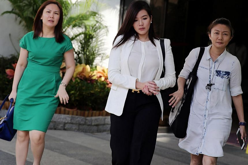 Rui En (centre) who was charged in court on June 22.