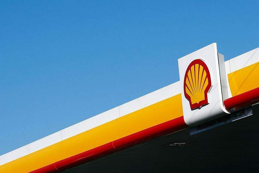 The Shell logo above the forecourt of a Royal Dutch Shell petrol station in Hook, England.