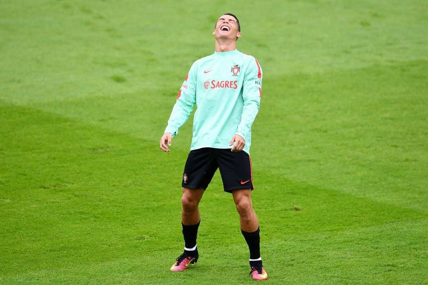 Portugal forward Cristiano Ronaldo enjoying a light moment during training at the team's base camp in Marcoussis, south of Paris. It has been a frustrating tournament for him so far, with none of his 20 goal attempts finding the net.