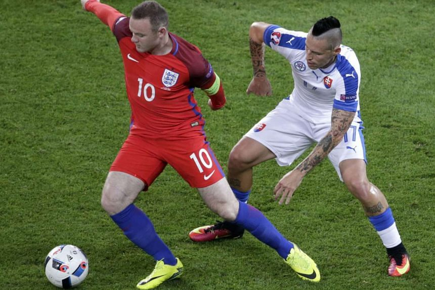 England's Wayne Rooney (left) shielding the ball from Marek Hamsik of Slovakia during the Group B stalemate. The England captain started from the bench and his team eventually settled for the group runners-up spot.