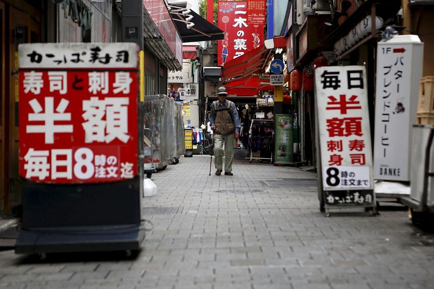 A restaurant row in Tokyo. At their April 27-28 meeting, members of the Bank of Japan held off on expanding monetary stimulus even as global headwinds, a strong yen and soft consumption threatened to derail the country's fragile economic recovery.