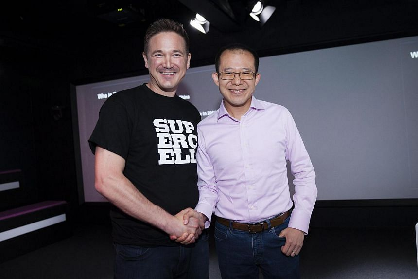 Supercell co-founder and CEO Ilkka Paananen (left) and Mr Martin Lau, president of Tencent, at a press conference in Helsinki, Finland.