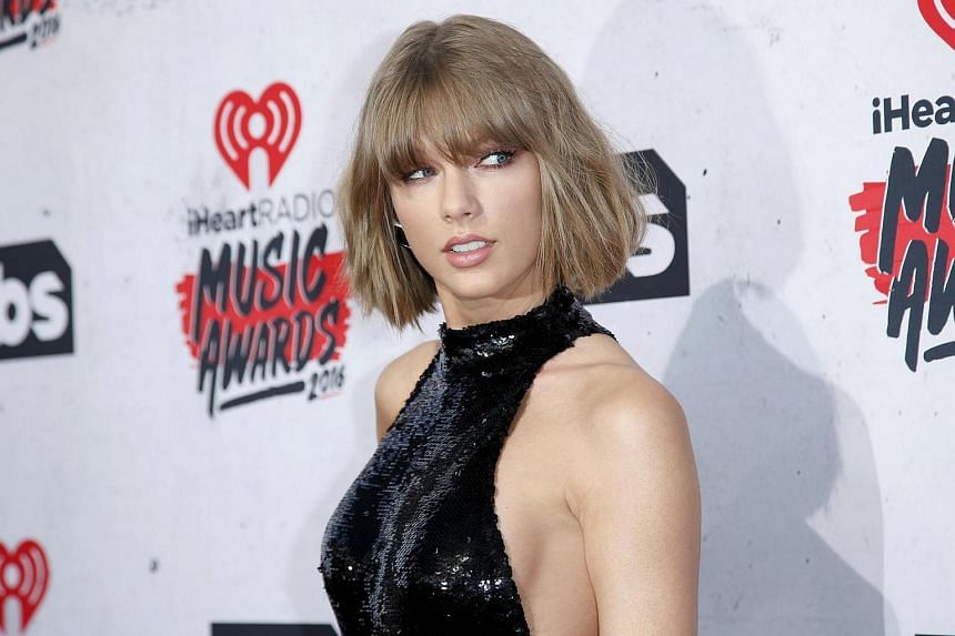Taylor Swift poses at the 2016 iHeartRadio Music Awards in Inglewood, California.