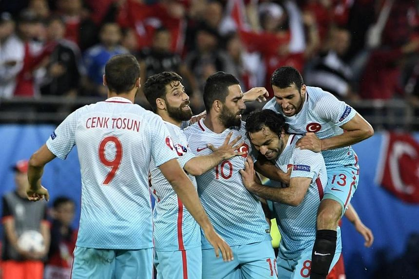 Turkish players celebrate their victory at the end of the Euro 2016 group D football match between Czech Republic and Turkey.