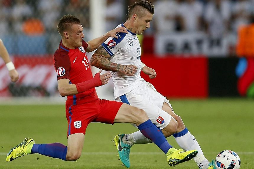 Marek Hamsik of Slovakia (right) and Jamie Vardy of England in action during their Uefa Euro 2016 group B football match.