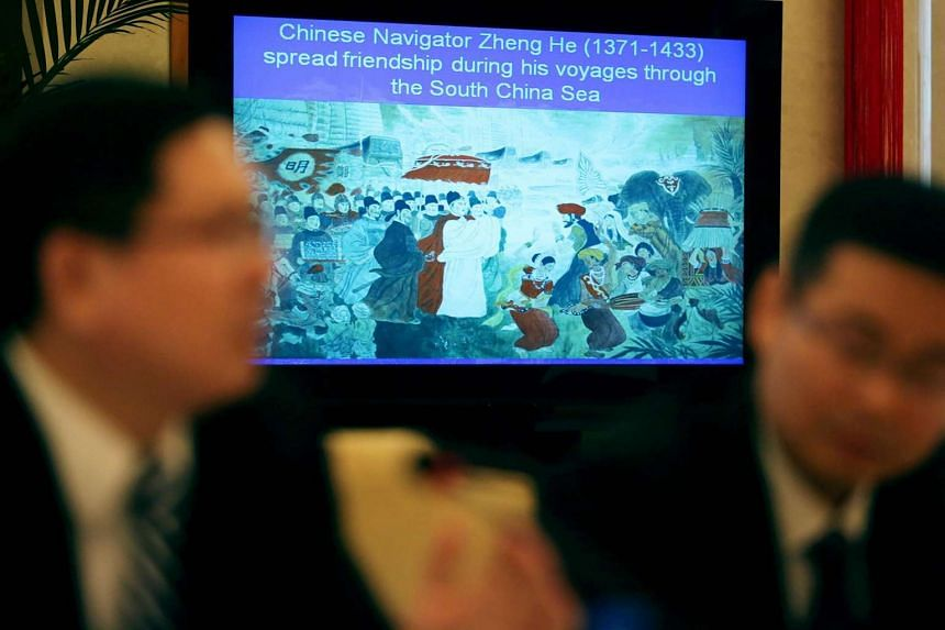 A monitor displays a slide show at The Minstry of Foreign Affairs of China at a press conference arranged to explain China's position on the South China Sea, on May 13, 2016.