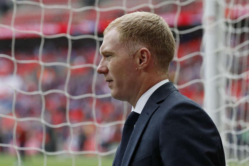 Paul Scholes has signed a three-year deal to play in India's new futsal league.