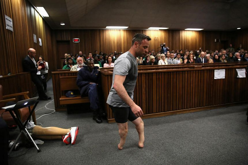 Oscar Pistorius walks across the courtroom without his prosthetic legs during the third day of the resentencing hearing, on June 15, 2016.
