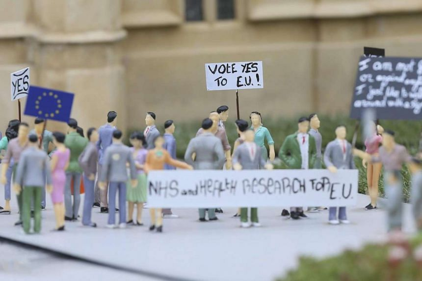 Figurines in front of a model of the British Parliament at the Mini-Europe park in Brussels on June 20.