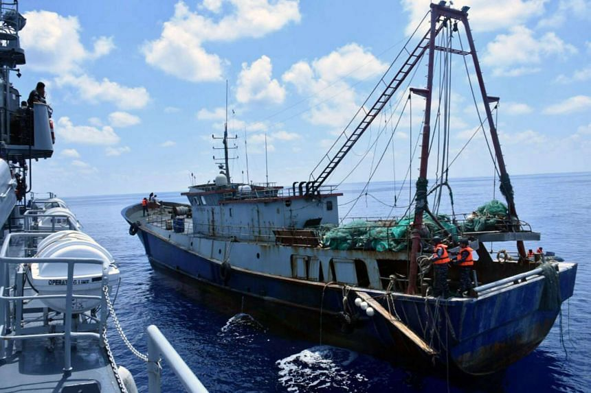 The Indonesian Navy vessel KRI Imam Bonjol (left) inspecting the Chinese-flagged fishing boat Han Tan Cou (right) in the waters near Natuna Islands, Riau Islands province, Indonesia, on June 17, 2016 in this Indonesian Navy handout photo provided by