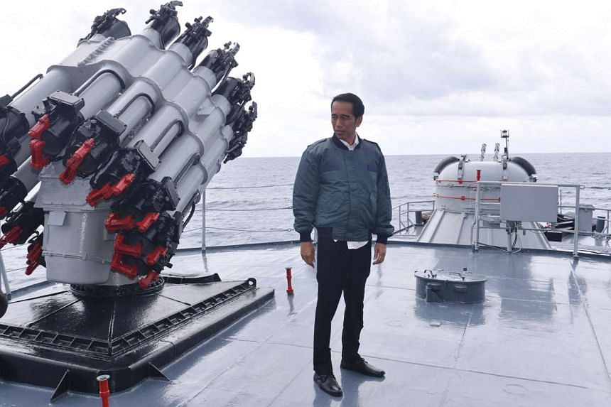 Indonesian President Joko Widodo standing on the deck of the Indonesian Navy ship KRI Imam Bonjol after chairing a limited Cabinet meeting in the waters of Natuna Islands, Riau Islands province, Indonesia on June 23, 2016 in this photo provided by An
