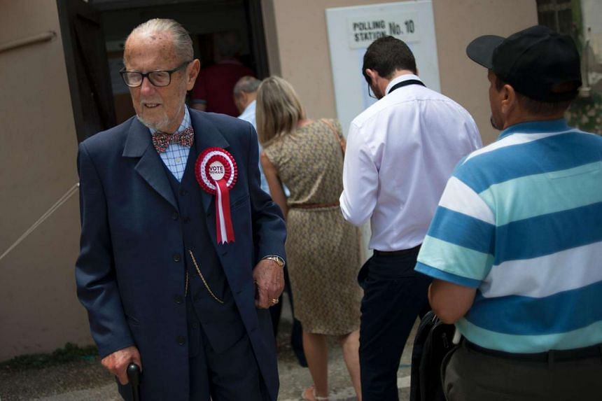 A man leaves a local polling station after casting his ballot in the UK referendum in Gibraltar, on June 23, 2016.