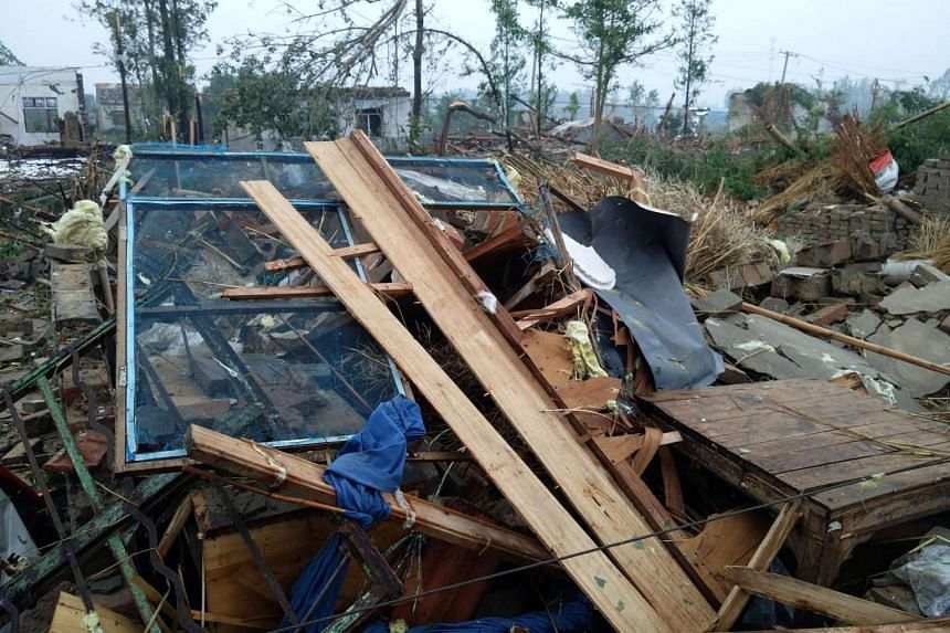 Damaged houses are seen after a tornado hit Funing county, Yancheng, Jiangsu province, on June 23, 2016.